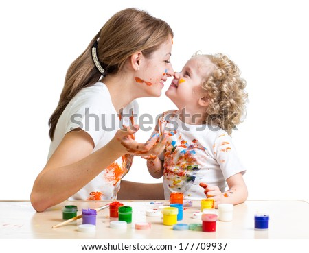 mother and kid girl painting together - stock photo