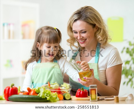 mother and kid girl preparing healthy food at home - stock photo