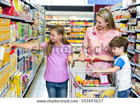 Mother and kids at the supermarket together - stock photo