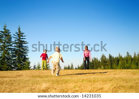 mother and kids having fun outside - stock photo