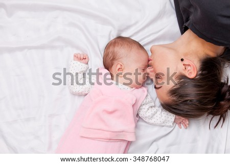 Mother and little baby in the bed  - stock photo