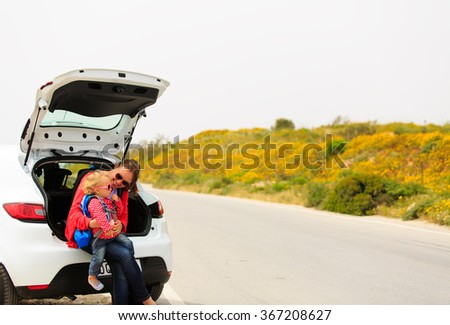 mother and little daughter travel by car - stock photo