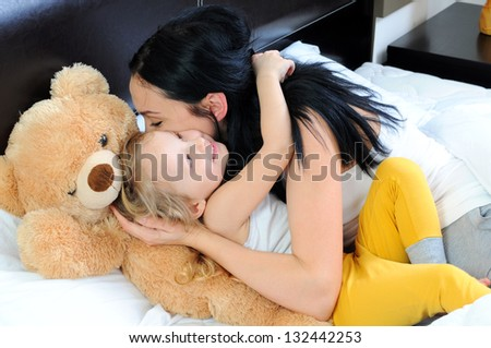 Mother and little girl having quality time together - stock photo