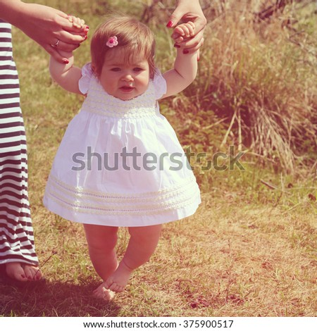 Mother and little girl together - instagram effect - stock photo