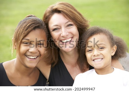 Mother and mixed race daughters - stock photo