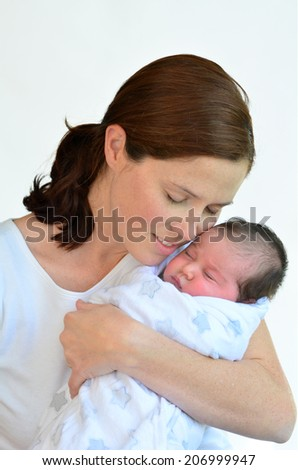 Mother and newborn baby kissing and hugging. concept photo happy family, motherhood, newborn, baby, lifestyle. - stock photo
