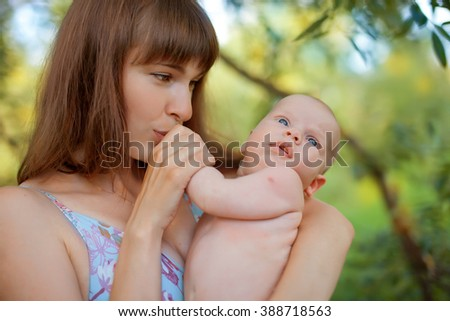 mother and newborn son in the park. Breast newborn. Breast engorgement.   papule on the arm following immunization - stock photo