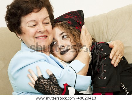 Mother and rebellious goth daughter hugging each other. - stock photo