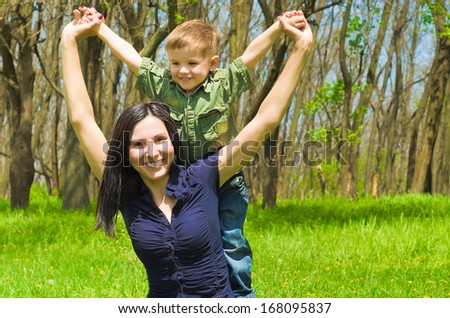 Mother and  son are having fun outdoors - stock photo