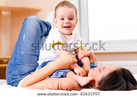 mother and son are playing at home - stock photo