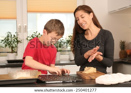 mother and son baking cookies - stock photo