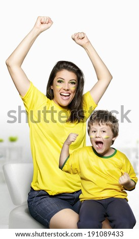 Mother and son celebrating by Brazil. - stock photo