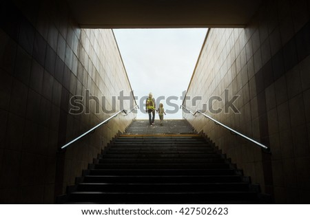 mother and son climbing stairs  - stock photo