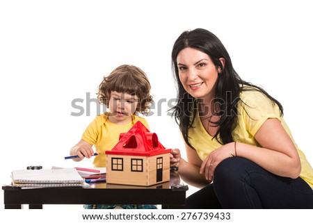 Mother and son drawing together isolated on white background - stock photo