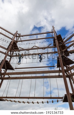 Mother and son fearless on an obstacle course - stock photo
