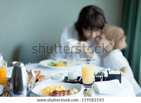 Mother and son having breakfast at a hotel - stock photo