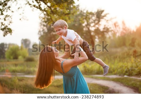 Mother and son having fun outdoors.  - stock photo
