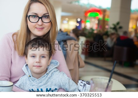 Mother and son having lunch together - stock photo