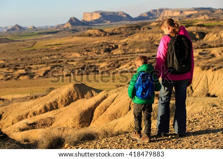 mother and son hiking in scenic mountains - stock photo