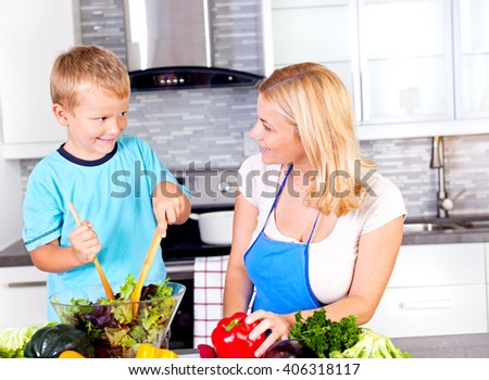 Mother and son in the kitchen  - stock photo