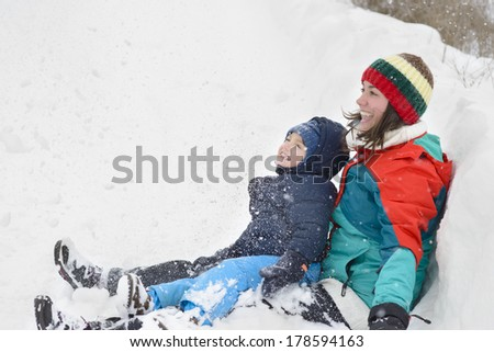 Mother and Son in Wintertime playing in snow - stock photo