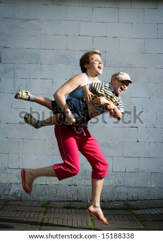 Mother and son jumping. - stock photo