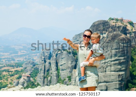 Mother and son looking at the town of Kalambaka bird's eye view. Meteora, Greece. - stock photo