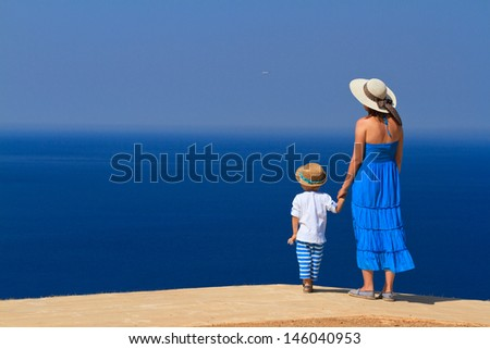 mother and son on sea vacation - stock photo