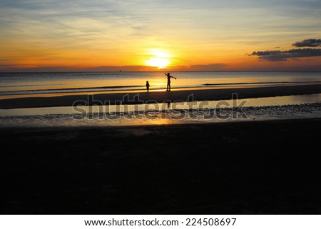 Mother and son on sunset  - stock photo