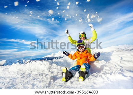 Mother and son on the mountain happy throw snow - stock photo