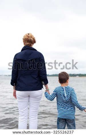Mother and son on the north sea - stock photo