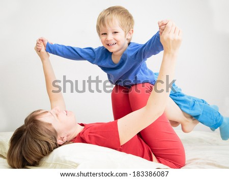 mother and son playing at home - stock photo