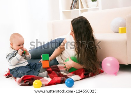 mother and son playing in room - stock photo
