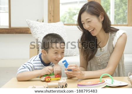 mother and son playing with toy - stock photo