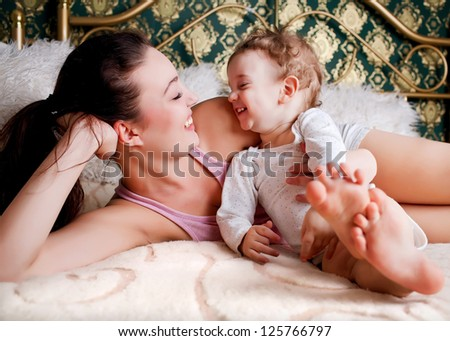 Mother and son relaxing together - stock photo