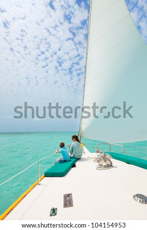 Mother and son relaxing while sailing on luxury yacht - stock photo
