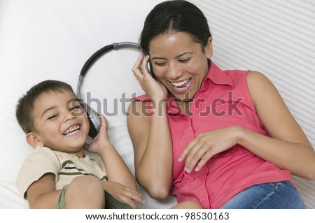 Mother and Son Sharing Headphones - stock photo