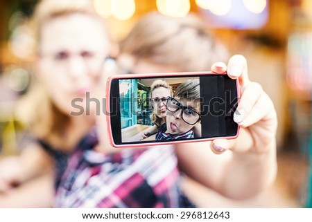 Mother and son taking selfie. Shallow depth of field  - stock photo