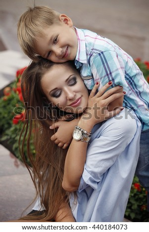 Mother and son walking in the park. Family, love, motherhood, childhood. - stock photo