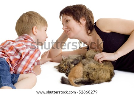mother and son with cat and eating kitten isolated on white background - stock photo