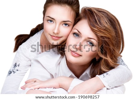 Mother and Teen Daughter. Close-up portrait of attractive happy mother and smiling teenage daughter isolated on a white background. Teenager girl with her mom - stock photo