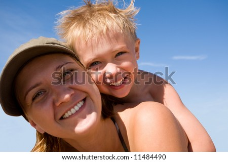 Mother and the child (son) on a beach in summer day. - stock photo