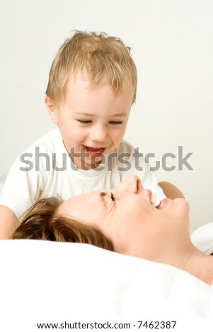 Mother and toddler sharing happy moment - stock photo