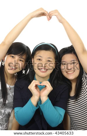 Mother and two daughters by posing - stock photo
