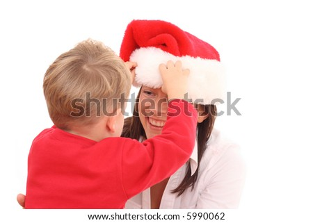 mother and 3-4 years old son having fun in Christmas hat isolated on white - stock photo