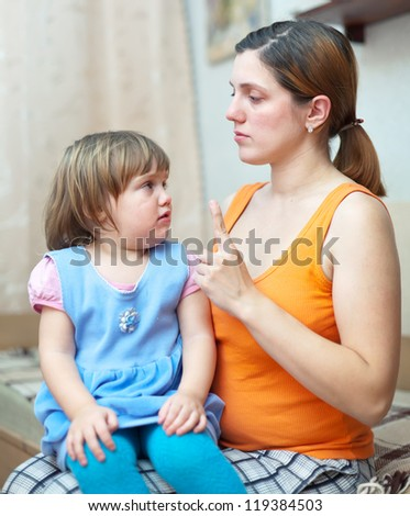 Mother berates her child athome - stock photo