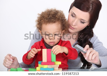 Mother bonding with son - stock photo