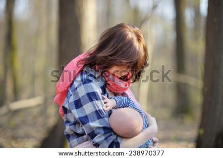Mother breastfeeding her baby  - stock photo