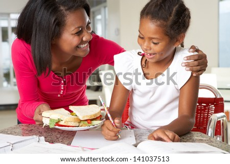 Mother Brings Daughter Sandwich Whilst She Studies - stock photo