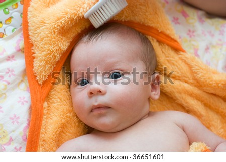 mother brushing her son with comb - stock photo